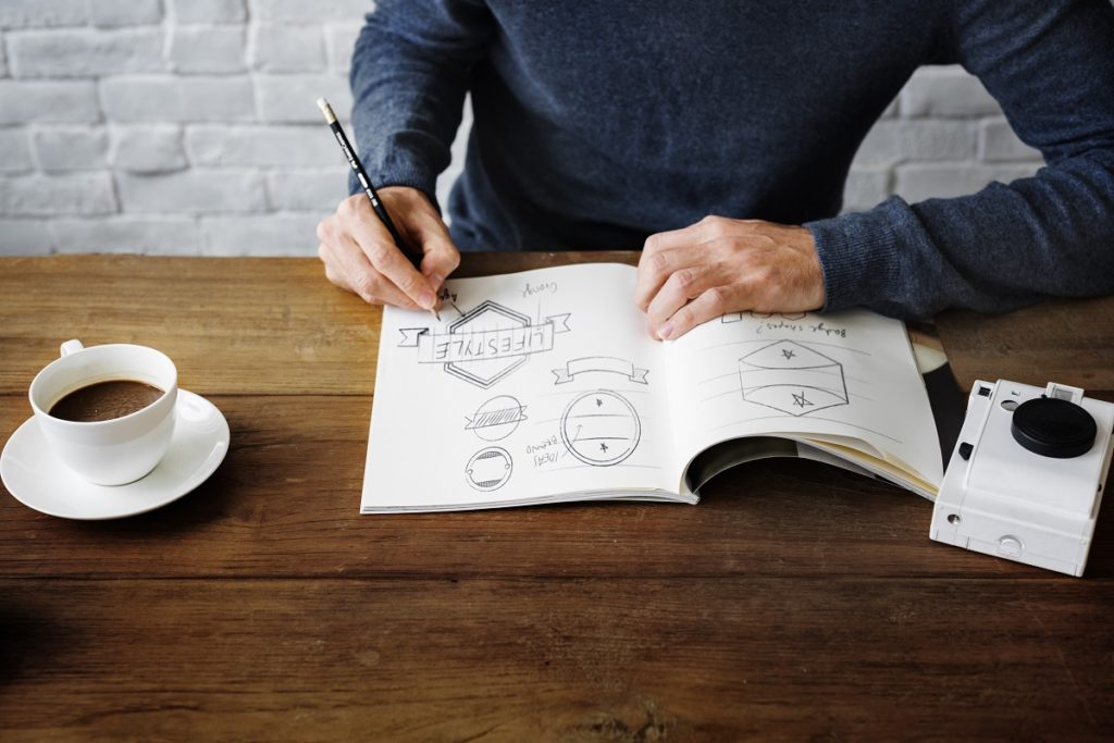 Man doodling on his journal
