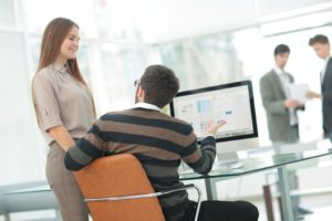 Man talking to woman about business website