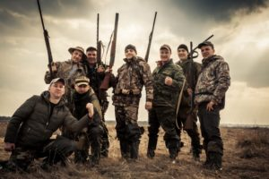 Men wearing hunting clothes
