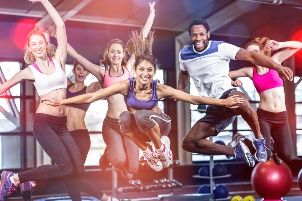 people taking jump shot inside a gym