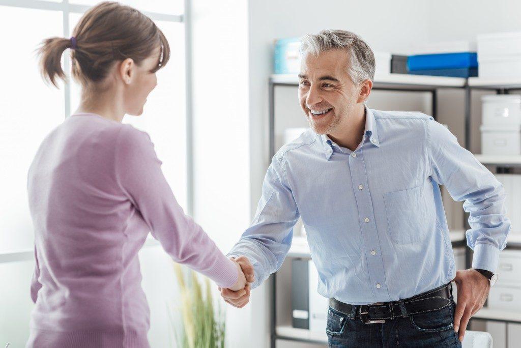 Woman shaking man's hand