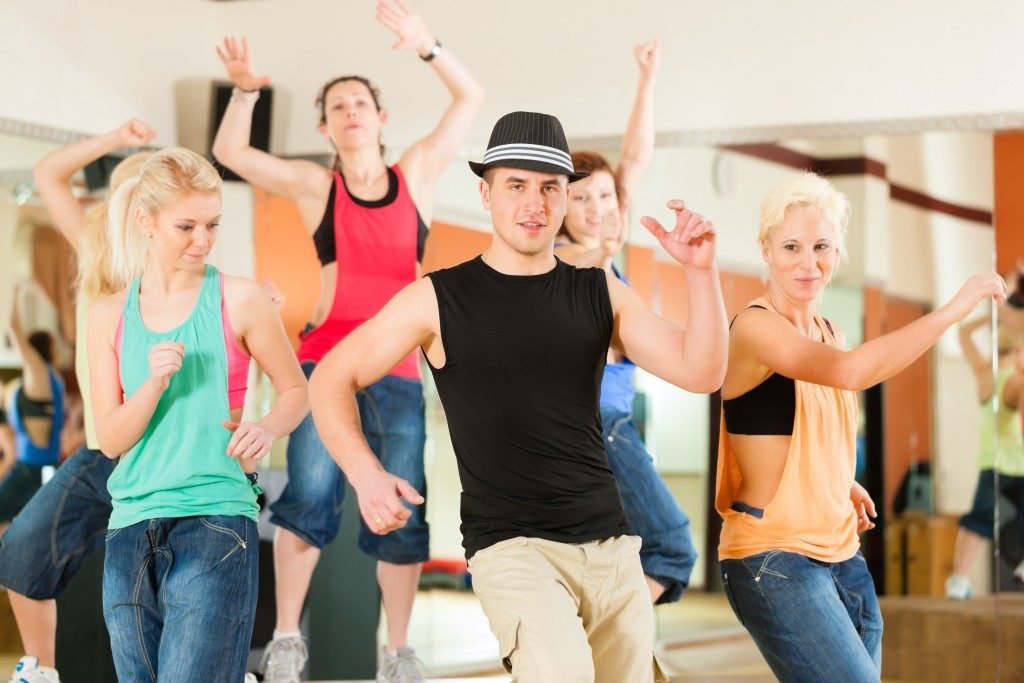 people dancing in a studio