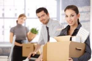 businesspeople moving office