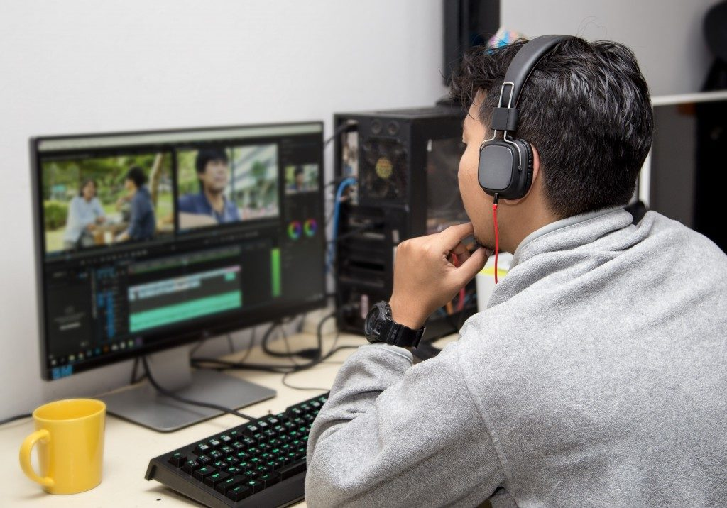 man editing a video