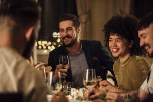group of millennials enjoying their wine