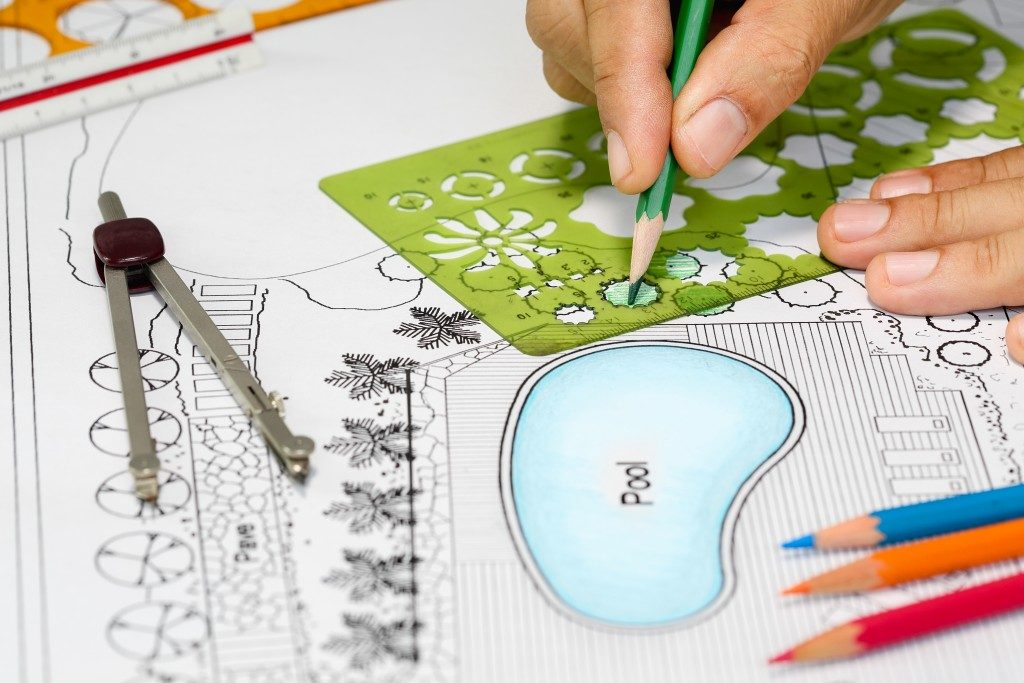 person designing a landscape