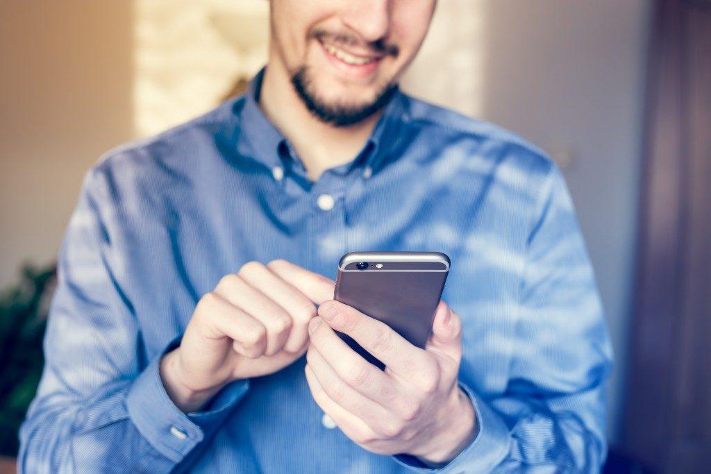 man using a smartphone