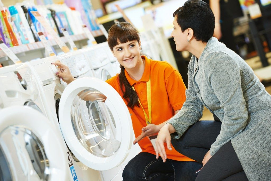 washing machine and saleswoman